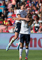 02 June 2013: U.S. National Team Player Alex Morgan #13 celebrates heir first goal with U.S. National Team Player Abby Wambach #20 during an international friendly soccer match between the U.S Women's National Team and the Canadian Women's National Team at BMO Field in Toronto, Ontario Canada.<br /> The U.S. National Women's Team won 3-0.