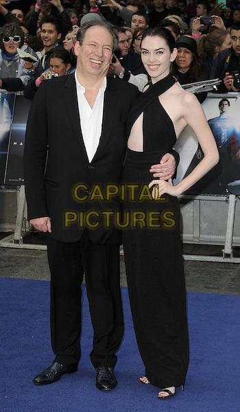 Hans Zimmer &amp; guest<br /> 'Man Of Steel' UK film premiere, Empire cinema, Leicester Square, London, England.<br /> 12th June 2013<br /> full length black suit dress criss cross halterneck hand on hip<br /> CAP/CAN<br /> &copy;Can Nguyen/Capital Pictures