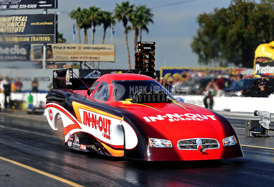 Feb. 19, 2010; Chandler, AZ, USA; NHRA funny car driver Melanie Troxel during qualifying for the Arizona Nationals at Firebird International Raceway. Mandatory Credit: Mark J. Rebilas-