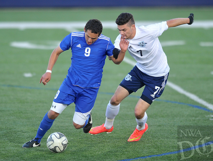 NWA Democrat-Gazette/Michael Woods --04/03/2015--w@NWAMICHAELW... Rogers Jorge Zamarrln (9) and Har-Ber's Cristian Carrillo (7) go after the ball during Friday nights game at Har-Ber High School in Springdale.