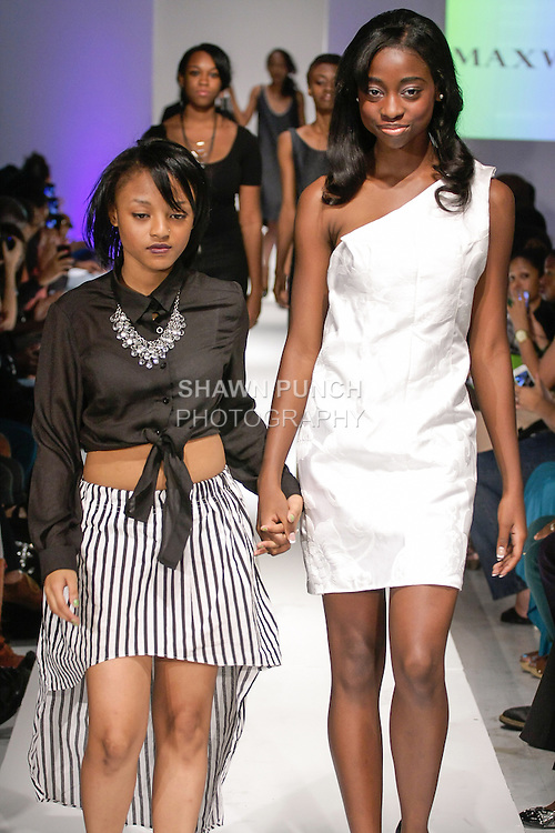 Student designer walks runway with model at the close of the Maxwell High School Spring 2013 student collection fashion show, during BK Fashion Weekend Spring Summer 2013, September 28, 2013.
