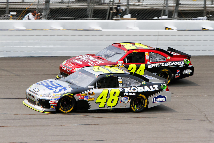 19 June, 2011: Jimmy Johnson (48) leads Jeff Gordon through turn four during the 43rd Annual Heluva Good! Sour Cream Dips 400 at Michigan International Speedway in Brooklyn, Michigan.