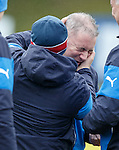 Kenny McDowall gets Ally McCoist in a headlock as he eats all the sweeties at training