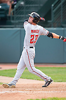 Jesse Winker (23) of the Billings Mustangs follows through on his swing against the Grand Junction Rockies at Suplizio Field on July 25, 2012 in Grand Junction, Colorado.  The Mustangs defeated the Rockies 12-11 in 10 innings.  (Brian Westerholt/Four Seam Images)