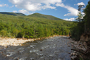 Severe riverbank erosion along the East Branch of the Pemigewasset River from Tropical Storm Irene in 2011 has opened up a view of the Hitchcock Mountain Range from along the Lincoln Woods Trail in Lincoln, New Hampshire. This tropical storm caused destruction along the East coast of the United States and the White Mountain National Forest of New Hampshire was officially closed during the storm.