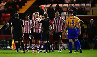Lincoln City's Michael O'Connor is shown a red card by referee Ross Joyce<br /> <br /> Photographer Chris Vaughan/CameraSport<br /> <br /> The EFL Checkatrade Trophy Group H - Lincoln City v Mansfield Town - Tuesday September 4th 2018 - Sincil Bank - Lincoln<br />  <br /> World Copyright © 2018 CameraSport. All rights reserved. 43 Linden Ave. Countesthorpe. Leicester. England. LE8 5PG - Tel: +44 (0) 116 277 4147 - admin@camerasport.com - www.camerasport.com