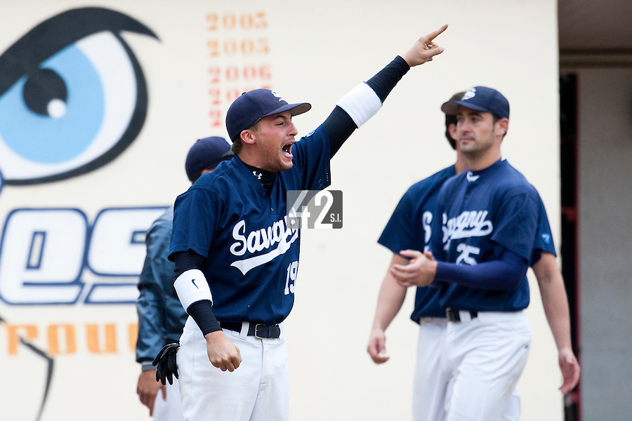 03 october 2009: Romain Scott Martinez celebrates as Steven Huff runs the bases following a back-to-back home run during game 1 of the 2009 French Elite Finals won 6-5 by Rouen over Savigny in the 11th inning, at Stade Pierre Rolland stadium in Rouen, France.