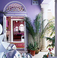 On the veranda mirrored glass baubles reflect the sunshine and bright colours of India