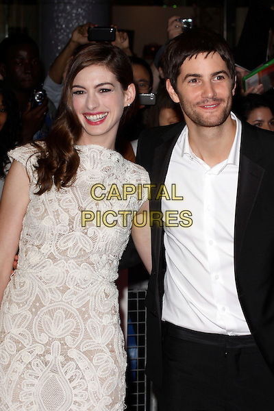 "ANNE HATHAWAY (in Alexander McQueen) & JIM STURGESS .""One Day"" UK premiere, Vue Westfield cinema, Westfield Shopping Centre, London, England..August 23rd, 2011.half length white sleeveless crochet lace dress white embroidered shirt black suit stubble facial hair arm around waist smiling .CAP/AH.©Adam Houghton/Capital Pictures."