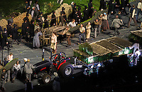 "27 JUL 2012 - LONDON, GBR - Actors playing farmworkers remove the rural scenery and props at the start of the ""Pandemonium"" section of the Opening Ceremony of the London 2012 Olympic Games in the Olympic Stadium in the Olympic Park, Stratford, London, Great Britain (PHOTO (C) 2012 NIGEL FARROW)"
