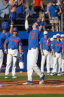 University of Florida Gators catcher JJ Schwarz (22) touching home plate after homering during a game against the Siena Saints at Alfred A. McKethan Stadium in Gainesville, Florida on February 17, 2018. Florida defeated Siena 10-2. (Robert Gurganus/Four Seam Images)