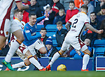 Barrie McKay skips past Chris Cadden and Richard Tait