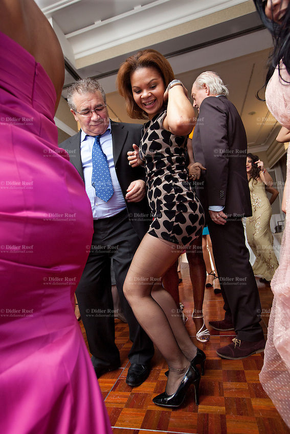 Switzerland. Geneva. Hotel Métropole. Wedding. Dance party. A dominican woman wears a mini-skirt with back hearts and high-heeled shoes. 9.11.13 © 2013 Didier Ruef