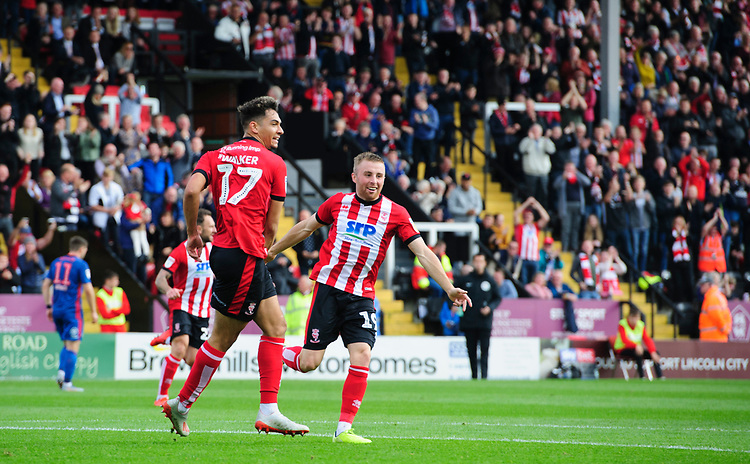 Lincoln City's Tyler Walker, left, celebrates scoring the opening goal with team-mate Joe Morrell<br /> <br /> Photographer Chris Vaughan/CameraSport<br /> <br /> The EFL Sky Bet League One - Lincoln City v Sunderland - Saturday 5th October 2019 - Sincil Bank - Lincoln<br /> <br /> World Copyright © 2019 CameraSport. All rights reserved. 43 Linden Ave. Countesthorpe. Leicester. England. LE8 5PG - Tel: +44 (0) 116 277 4147 - admin@camerasport.com - www.camerasport.com