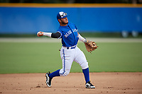GCL Blue Jays third baseman Yhon Perez (6) throws to first base during a Gulf Coast League game against the GCL Tigers West on August 3, 2019 at the Englebert Complex in Dunedin, Florida.  GCL Blue Jays defeated the GCL Tigers West 4-3.  (Mike Janes/Four Seam Images)