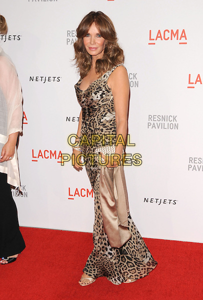"JACLYN SMITH .at LACMA's ""The Unmasking"" The Lynda & Stewart Resnick Exhibition Pavilion Opening Gala at The Los Angeles County Museum of Art in Los Angeles, California, USA, September 25th 2010..full length animal leopard print dress long maxi brown clutch bag woven .CAP/RKE/DVS.©DVS/RockinExposures/Capital Pictures."