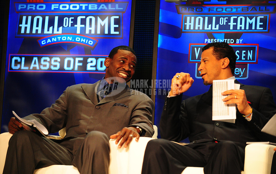 February 5, 2011; Dallas, TX, USA; Michael Irvin (left) talks to Rod Woodson (right) before a press conference naming the NFL Hall of Fame class of 2011 at the Super Bowl XLV media center. Mandatory Credit: Mark J. Rebilas-