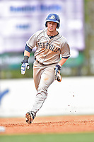 Asheville Tourists second baseman Brendan Rodgers (1) runs to third during a game against the  Greenville Drive at Fluor Field on April 10, 2016 in Greenville South Carolina. The Drive defeated the Tourists 7-4. (Tony Farlow/Four Seam Images)