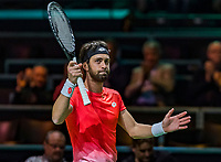 Rotterdam, The Netherlands, 11 Februari 2019, ABNAMRO World Tennis Tournament, Ahoy, first round singles:  Nikoloz Basilashvili (GEO) tries to be happy after his win<br /> Photo: www.tennisimages.com/Henk Koster