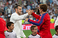 Gareth Bale of Real Madrid and Antoine Griezmann of Atletico Madrid during the match between Real Madrid v Atletico Madrid of LaLiga, date 7, 2018-2019 season. Santiago Bernabéu Stadium. Madrid, Spain - 29 SEP 2018.