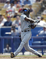 Preston Wilson of the Florida Marlins bats during a 2002 MLB season game against the Los Angeles Dodgers at Dodger Stadium, in Los Angeles, California. (Larry Goren/Four Seam Images)
