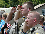 Waterloo police officers (from left) Sgt. Eric Zaber, Patrolman Mason Ingram and Acting Sgt. Dave Midkiff salute as the procession passes by. Dozens of police departments joined in the procession from St. Louis to Waterloo for slain Illinois State Police Trooper Nick Hopkins on Monday August 26, 2019. <br /> Photo by Tim Vizer