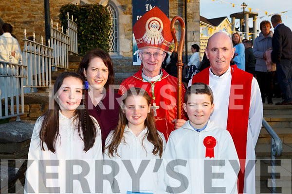Pupils from Holymount NS with Bishop Ray Browne, Aoife Golden teacher and Fr Pat O'Donnell l-r: Sarah Moynihan, Tiarna Dineen and David O'Leary at their Confirmation in St Josephs church Rathmore on Tuesday