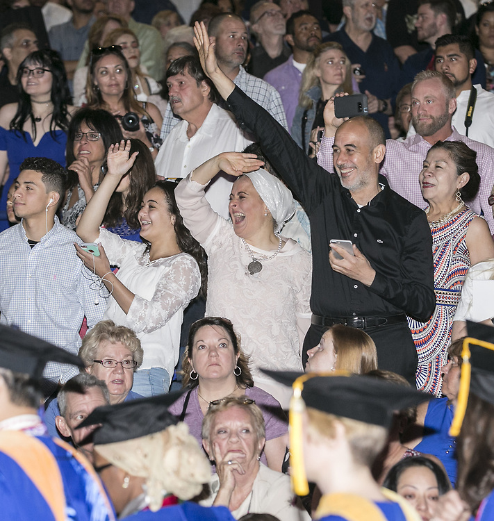Friends and family members search for their graduates Sunday, June 11, 2017, during the DePaul University College of Science and Health and College of Liberal Arts and Social Sciences commencement ceremony at the Allstate Arena in Rosemont, IL. (DePaul University/Jamie Moncrief)
