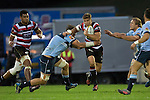 Piers Francis tries to fend off Shane Neville. The game of Three Halves, a pre-season warm-up game between the Counties Manukau Steelers, Northland and the All Blacks, played at ECOLight Stadium, Pukekohe, on Friday August 12th 2016. Photo by Richard Spranger.