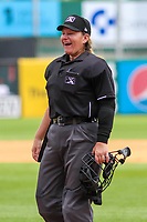 Home plate umpire Jennifer Pawol laughs between innings during a Midwest League game between the Wisconsin Timber Rattlers and the Bowling Green Hot Rods on July 23, 2018 at Fox Cities Stadium in Appleton, Wisconsin. Wisconsin defeated Bowling Green 5-3. (Brad Krause/Four Seam Images)