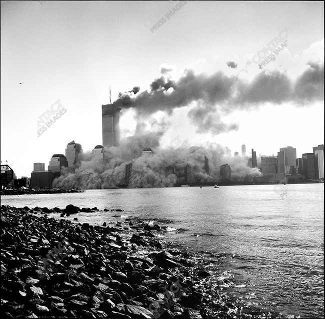 Collapse of the first tower from the terrorist attack on the World Trade Center, view from Jersey City, New Jersey, USA, September 11, 2001