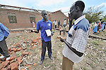 Philip Nyumba, center, talks with teachers and community leaders as he inspects construction of a school in the Southern Sudanese village of Mankaro. The school is being constructed by the United Methodist Committee on Relief (UMCOR). Nyumba is the deputy program manager for UMCOR in Southern Sudan. Families here are rebuilding their lives after returning from refuge in Uganda in 2006 following the 2005 Comprehensive Peace Agreement between the north and south. . NOTE: In July 2011, Southern Sudan became the independent country of South Sudan