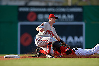 Auburn Doubledays second baseman Phil Caulfield (1) tags Dalvy Rosario (17) sliding in during a NY-Penn League game against the Batavia Muckdogs on June 14, 2019 at Dwyer Stadium in Batavia, New York.  Batavia defeated 2-0.  (Mike Janes/Four Seam Images)