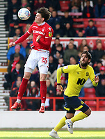 Nottingham Forest's Sam Byram heads away from Blackburn Rovers' Danny Graham<br /> <br /> Photographer David Shipman/CameraSport<br /> <br /> The EFL Sky Bet Championship - Nottingham Forest v Blackburn Rovers - Saturday 13th April 2019 - The City Ground - Nottingham<br /> <br /> World Copyright © 2019 CameraSport. All rights reserved. 43 Linden Ave. Countesthorpe. Leicester. England. LE8 5PG - Tel: +44 (0) 116 277 4147 - admin@camerasport.com - www.camerasport.com
