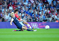 August 09, 2012: United States' Megan Rapinoe and Japan's Yukari Kinga in action during Football Final match at the Wembley Stadium on day thirteen in Wembley, England. USA defeat Japan 2-1 to win it's third consecutive Olympic gold medal in women's soccer. ..