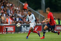 Nathan Redmond (Southampton) of England goes past Ulrik Yttergard Jenssen (Tromso) of Norway during the International EURO U21 QUALIFYING - GROUP 9 match between England U21 and Norway U21 at the Weston Homes Community Stadium, Colchester, England on 6 September 2016. Photo by Andy Rowland / PRiME Media Images.