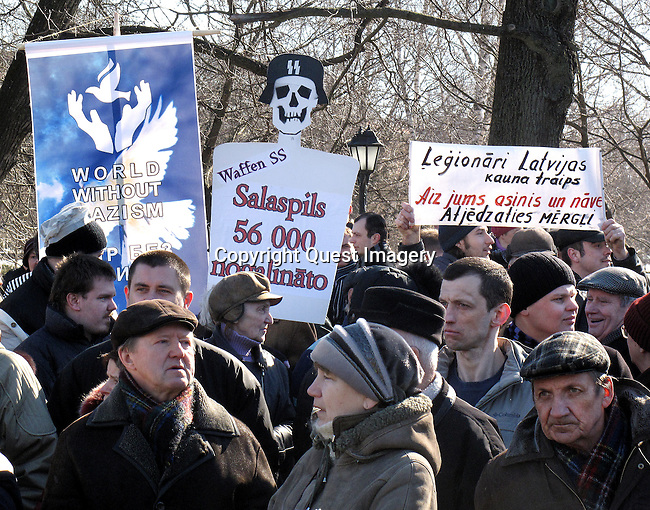 Latvians pay tribute to soldiers who fought in Nazi Germany's Waffen SS divisions, while nearby Russians held a counter protest to recall war crimes committed against Jews and other minorities.  <br /> Photo by Deirdre Hamill/Quest Imagery