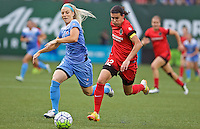 Portland, Oregon - Wednesday June 22, 2016: Portland Thorns FC forward Christine Sinclair (12) controls the ball in front of Chicago Red Stars defender Julie Johnston (8) during a regular season National Women's Soccer League (NWSL) match at Providence Park.