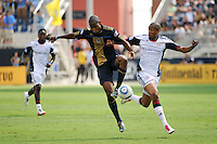 Danny Mwanga (10) of the Philadelphia Union and Darrius Barnes (25) of the New England Revolution battle for the ball. The Philadelphia Union and the New England Revolution  played to a 1-1 tie during a Major League Soccer (MLS) match at PPL Park in Chester, PA, on July 31, 2010.