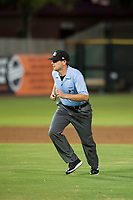 Minor League Umpire Jeff Hamann handles the calls on the bases during a game between the AZL Brewers and AZL Giants on August 15, 2017 at Scottsdale Stadium in Scottsdale, Arizona. AZL Giants defeated the AZL Brewers 4-3. (Zachary Lucy/Four Seam Images)