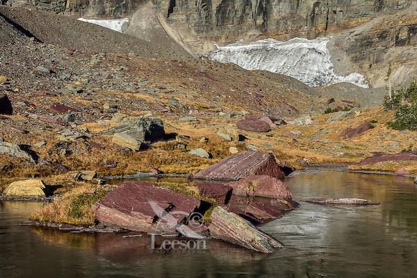 Frozen alpine tarn in Glacier National Park, Montana.  Fall.