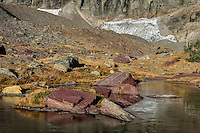 Frozen alpine tarn in Glacier National Park, Montana.  Fall.