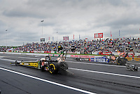 Jun. 1, 2012; Englishtown, NJ, USA: NHRA top fuel dragster driver Morgan Lucas (left) races alongside Antron Brown during qualifying for the Supernationals at Raceway Park. Mandatory Credit: Mark J. Rebilas-