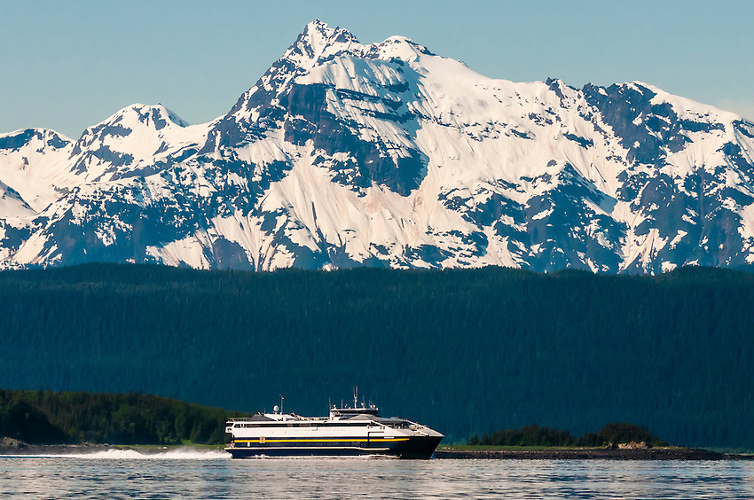 Alaska Marine Highway (a.k.a. Alaska State Ferry) ship MV Fairweather cruising down the Lynn Canal (deepest fjord in North America), near Juneau, Inside Passage, Southeast Alaska USA.