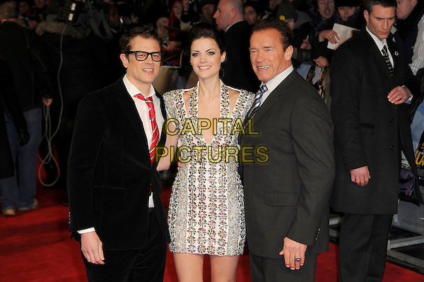 Johnny Knoxville, Jaimie Alexander and Arnold Schwarzenegger.'The Last Stand' UK film premiere at Odeon West End cinema, Leicester Square, London, England..22nd January 2013.half length dress low cut neckline white silver halterneck embellished jewel encrusted metallic black grey gray suit shirt red tie glasses .CAP/MAR.© Martin Harris/Capital Pictures.