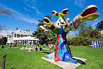 April 21, 2013 - Roslyn Harbor, New York, U.S. - At Celebrate Earth Day at Nassau County Museum of Art, children paint pictures on large rolls of paper on lawn near SNAKE TREE, a colorful, large mixed media sculptural installation by Niki de Saint Phalle.