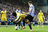 (L-R) Nathan Dyer of Swansea City is brought down by Morgan Fox of Sheffield Wednesday during the Sky Bet Championship match between Sheffield Wednesday and Swansea City at Hillsborough Stadium, Sheffield, England, UK. Saturday 09 November 2019