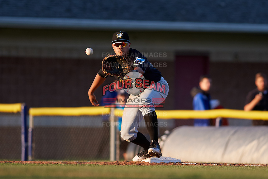 West Virginia Black Bears first baseman Jose Barraza (23) waits to receive a throw during a game against the Batavia Muckdogs on August 5, 2017 at Dwyer Stadium in Batavia, New York.  Batavia defeated Williamsport 3-2.  (Mike Janes/Four Seam Images)