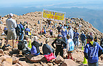August 15, 2015 - Manitou Springs, Colorado, U.S. - Spectators gather on the summit of Pikes Peak to celebrate runners completing the Pikes Peak Ascent during the 60th running of the Pikes Peak Ascent and Marathon.  During the Ascent, runners cover 13.3 miles and gain more than 7815 feet (2382m) by the time they reach the 14,115ft (4302m) summit.  On the second day of race weekend, 800 marathoners will make the round trip and cover 26.6 miles of high altitude and very difficult terrain in Pike National Forest, Manitou Springs, CO.