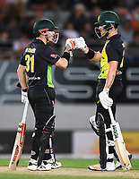 David Warner and D'Arch Short (R).<br /> New Zealand Black Caps v Australia.Tri-Series International Twenty20 cricket final. Eden Park, Auckland, New Zealand. Wednesday 21 February 2018. &copy; Copyright Photo: Andrew Cornaga / www.Photosport.nz